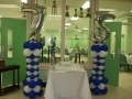Blue and white birthday column with 75th balloon silver number topper