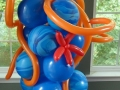 Blue column with an orange octopus topping