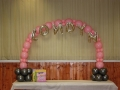 Pink and gray table arch for baby shower