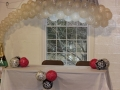 Champagne arch for bride and groom table